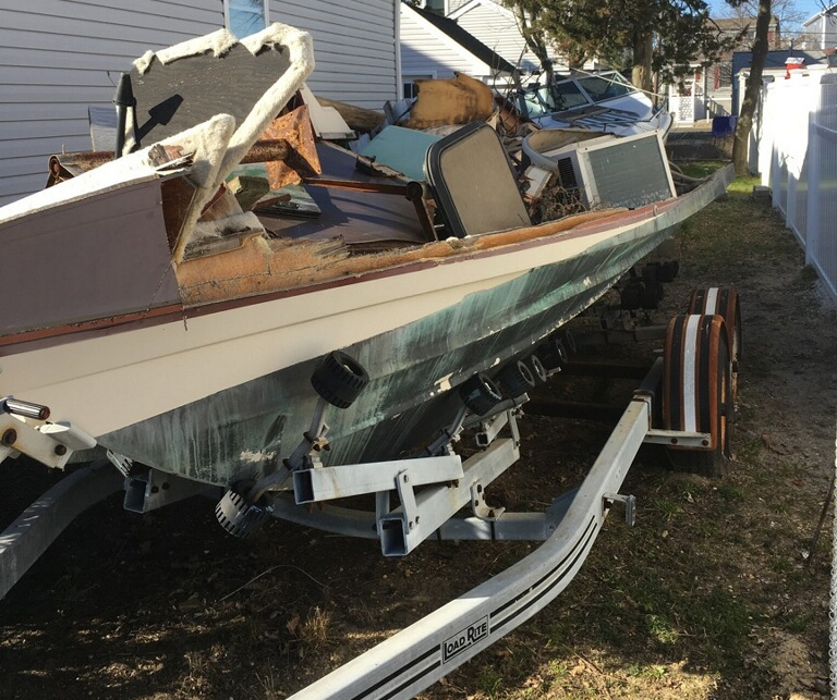 Junk boat removal ocean county dumpsters and junk for Outboard motor salvage yard